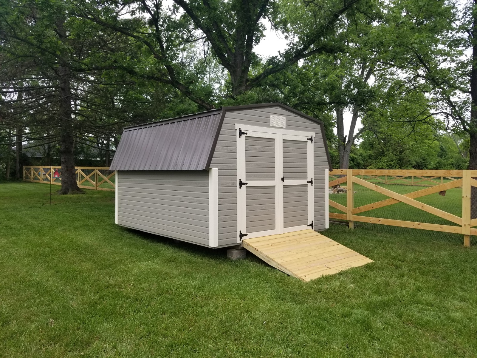 tan mini barn with white trim